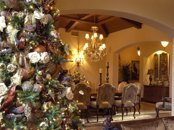 Wide view of decorated room with christmas tree.